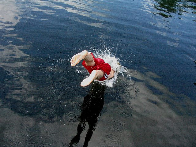 dive headfirst